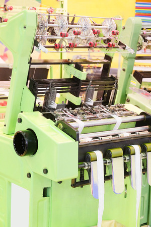 the textile industry: Textile industry - weaving machine Stock Photo