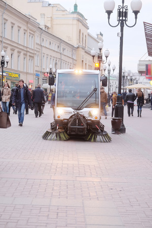 brooming: MOSCOW, RUSSIA - APRIL 22, 2015: Sweeping machine cleans the street in Moscow
