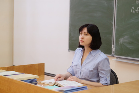 pedagogical: The image of a girl teacher in a class Stock Photo