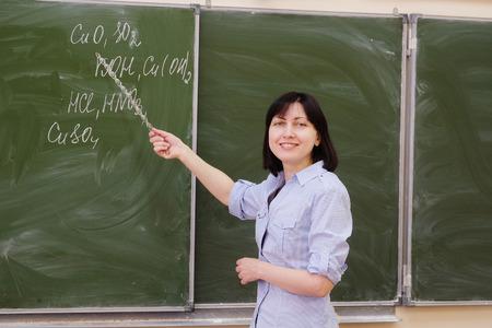 obligatory: The girl teacher stands at a blackboard