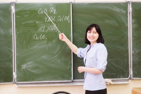 pedagogical: The girl teacher stands at a blackboard