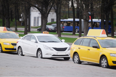 a yellow taxi: Moscow, Russia, May, 4, 2015: taxi parking on the Sparrow Hills in Moscow Editorial