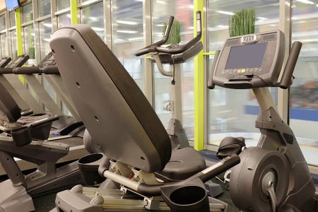 Modern interior of a fitness club gym with sport equipment modern interior photo