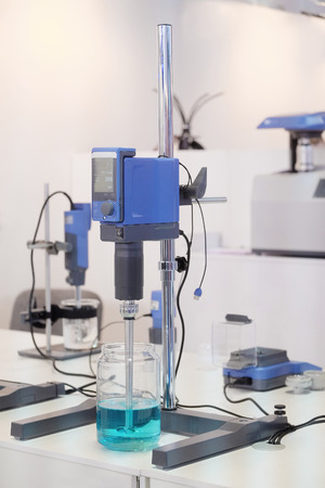 chemical substance: Laboratory equipment. Blue chemical substance in the beaker. Laboratory stirrers