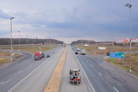 express lane: Moscow region, Russia, April, 27, 2015: Day traffic on a Simferopol shosse in Moscow region, Russia Editorial