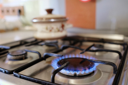 oven: gas burning from a kitchen gas stove