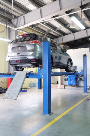 auto lift: Serpuhov, Russia, June, 23, 2015: Cars in a dealer repair station in Serpuhov, Russia Editorial