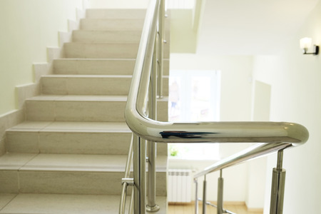 handrails: Staircase in modern building. Closeup stainless steel handrails.