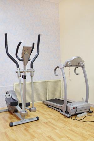 crosstrainer: treadmill in a fitness hall