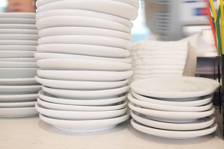 bar ware: Washed plates in a restaurant