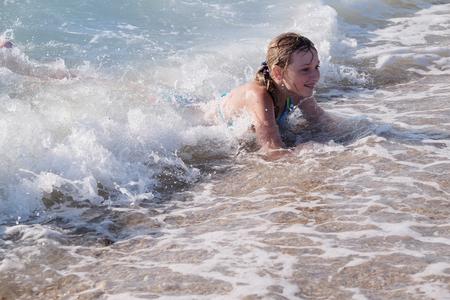 children play: Children play in a sea surf