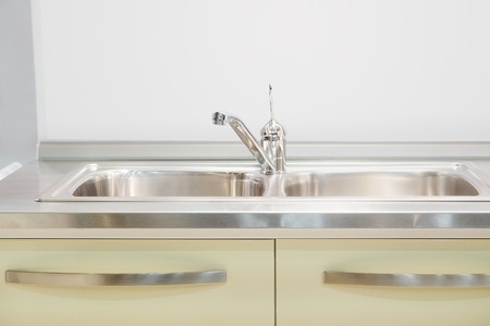 recessed: Stainless steel wash sinks with mixer tap Stock Photo