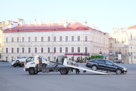 St. Petersburg, Russia, June, 7, 2015: The wrecker evacuates incorrectly parked car from Palace Square in St. Petersburg, Russia Editorial