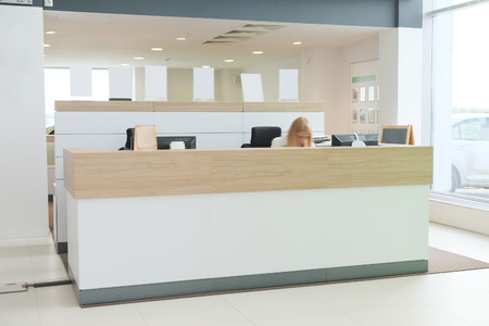 dealers: Working place of managers in a dealers car showroom Editorial
