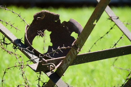 perish: The shot soldiers helmet on a barbed wire Stock Photo