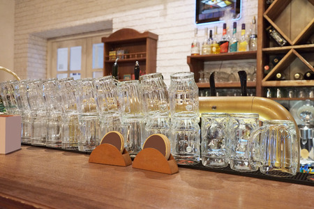 bar ware: Glasses on a bar counter Stock Photo