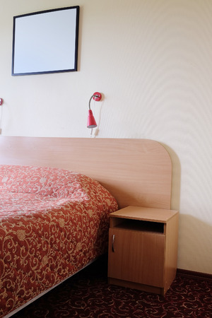 bedstead: Interior of a hotel bedroom Stock Photo
