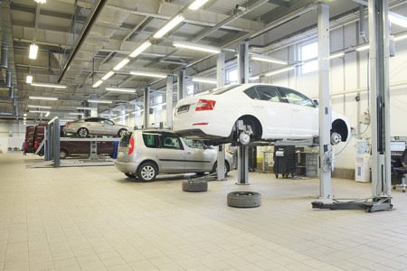 auto lift: Interior of a car repair station
