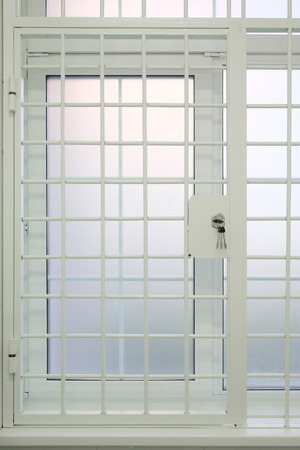 incarcerate: Metal bars with the lock close up Stock Photo