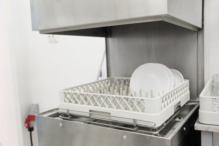 The image of a professional dishwasher Stock Photo