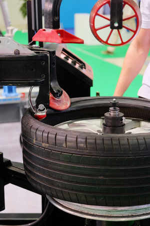 hauler: modern tire machine in the service station Stock Photo