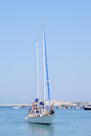 sailer: The image of sailer in the sea Editorial