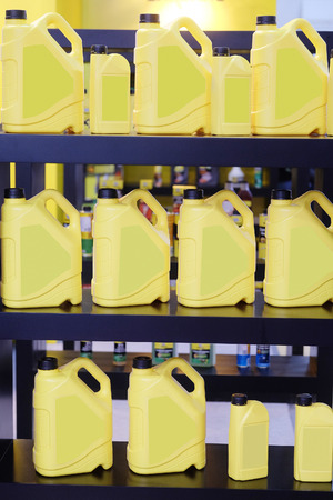 motor oil: shelves in an auto parts store with the motor oil