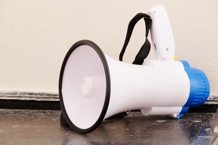 mega phone: megaphone stands on the floor