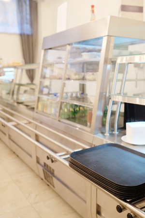 arranging chairs: the interior of the café, self-service