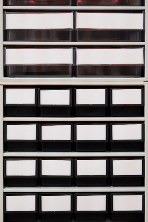prefab: rows of plastic boxes for components Stock Photo
