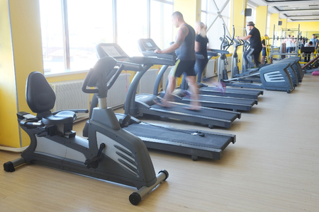 wight: People train on the treadmill in the gym