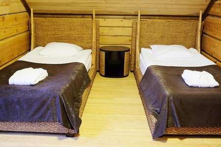 bedsheet: Two beds in motel room Stock Photo