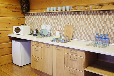 tiled stove: Interior of a little kitchen