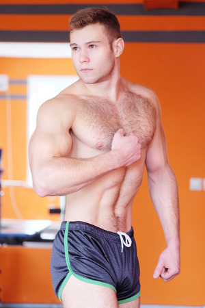 muscle guy: man is engaged in fitness Stock Photo