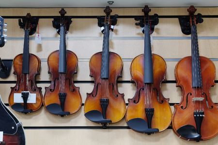 violins: The image of a violins in a shop Stock Photo