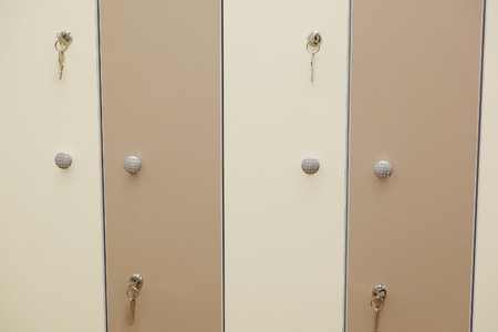 pool rooms: White umbrella on a closed doors in a cloak-room