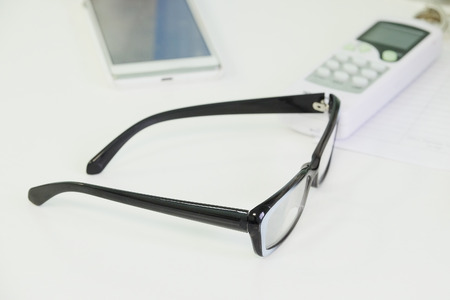 shortsightedness: The image of a glasses on a table