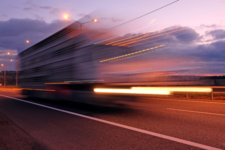 fuel truck: Truck on a highway in the night Stock Photo