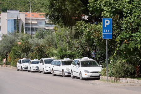 sectoring: Budva, Montenegro, September, 1, 2015: Taxi cars on the parking in Budva, Montenegro Editorial