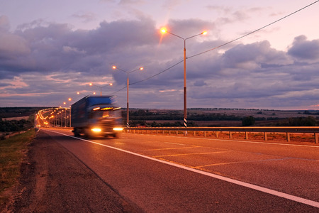 Truck on a highway in the night Stockfoto