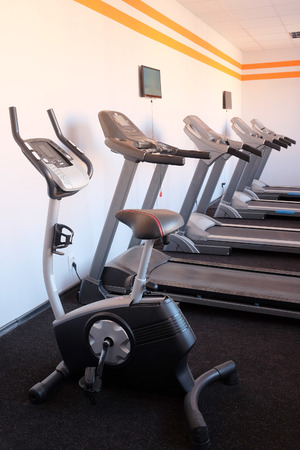 treadmill: Set of treadmills staying in line in the gym