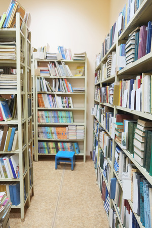 bookcover: The image of books on the shelf in a library
