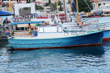 berth: The image of motor boat stand at a berth Editorial