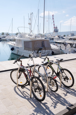 stone cutter: Bikes on a Tivat embankment, Montenegro Stock Photo