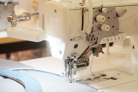 stitchwork: Part of an industrial sewing machine Stock Photo