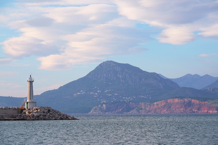 ridge of wave: Landscape with the image of lighthouse in Bar harborn, Montenegro