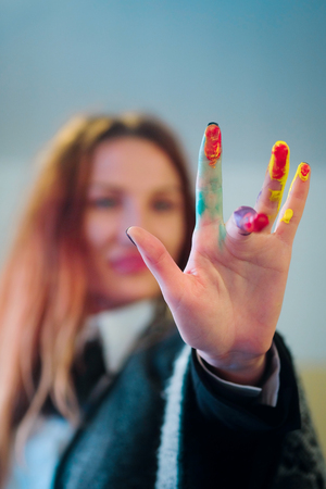 jabot: The image of artists hand coloured by the paints Stock Photo