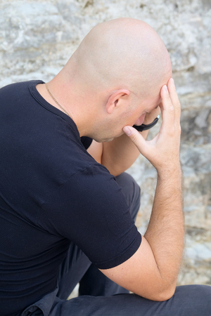 suffered: Portrait of a bald headed suffered man Stock Photo