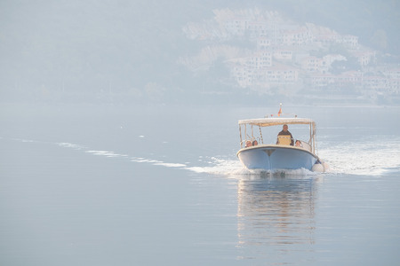 stone cutter: The image of boat in a Kotor  bay, Montenegro Stock Photo