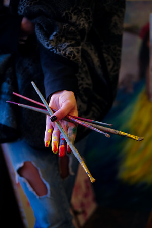 jabot: Hand of artist with brushes Stock Photo